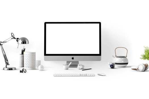 A silver Macbook on a desk stock image for web design trends